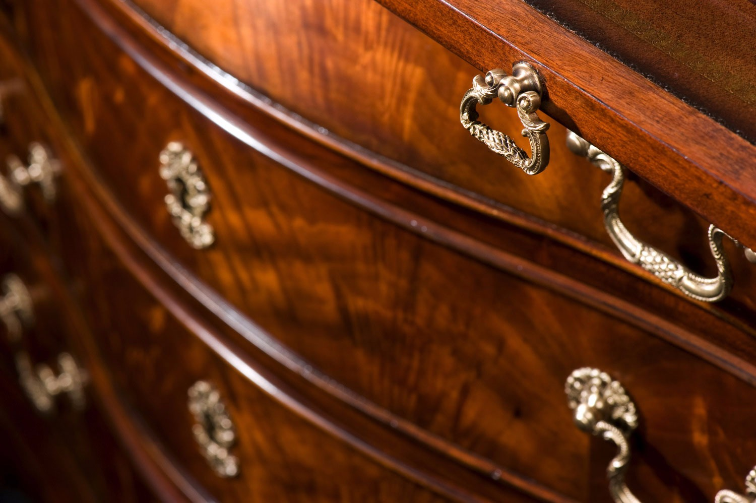 A large George II mahogany bombe chest of drawers