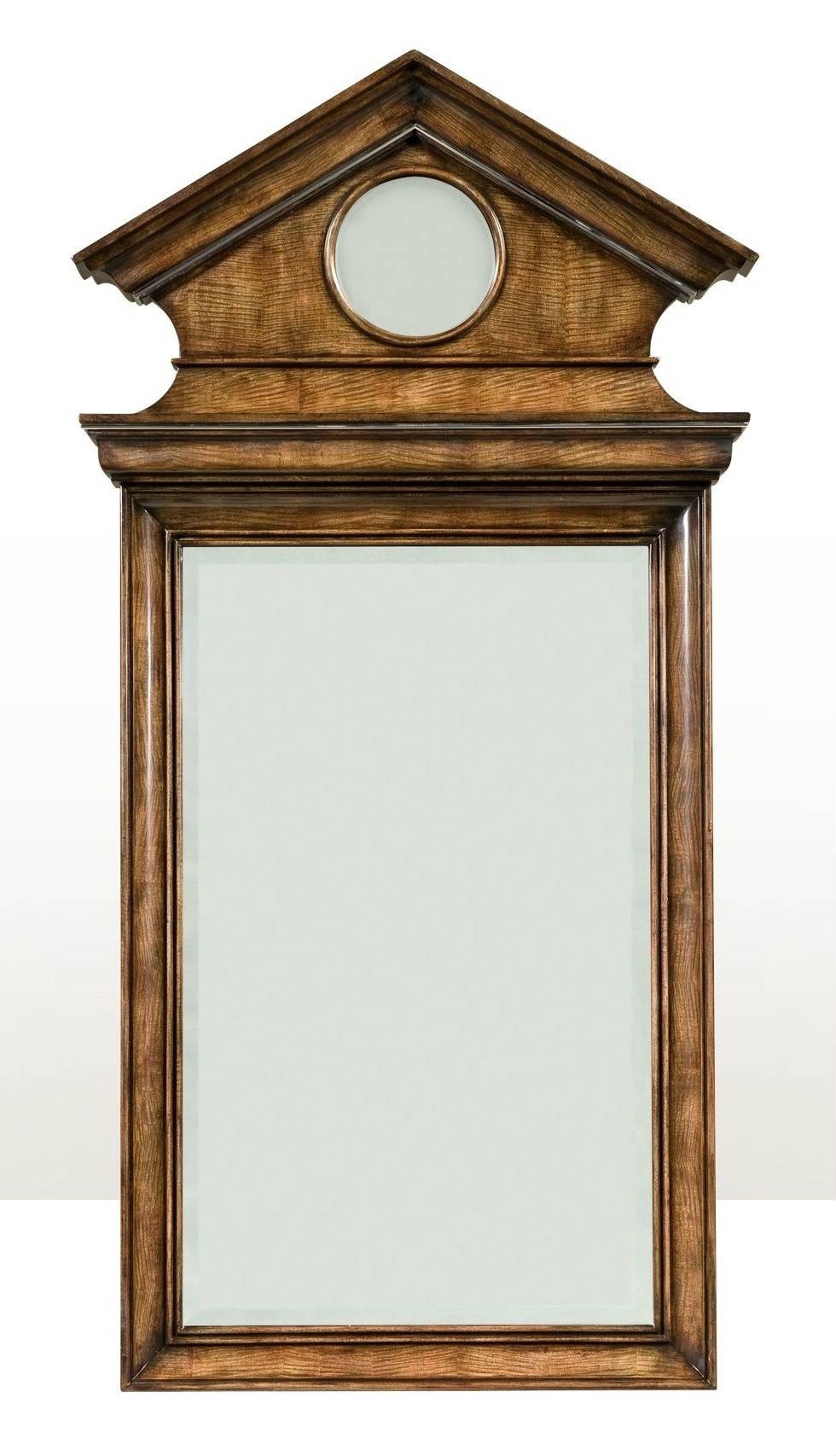 A mahogany and figured anegre veneered wall mirror