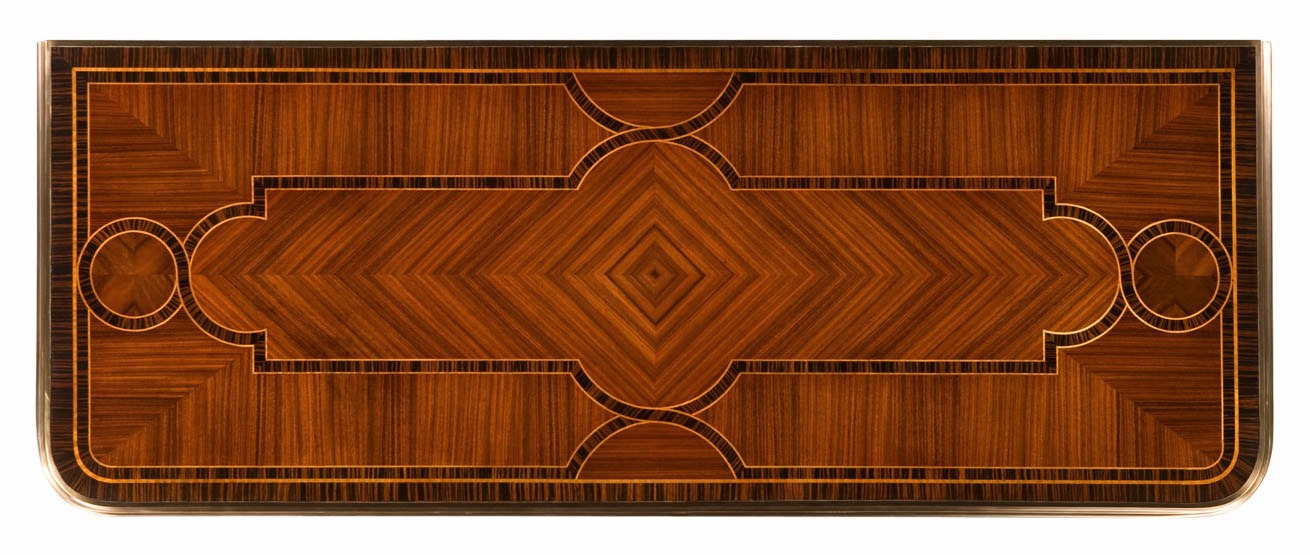 A serpentine mahogany chest of drawers with strapwork marquetry