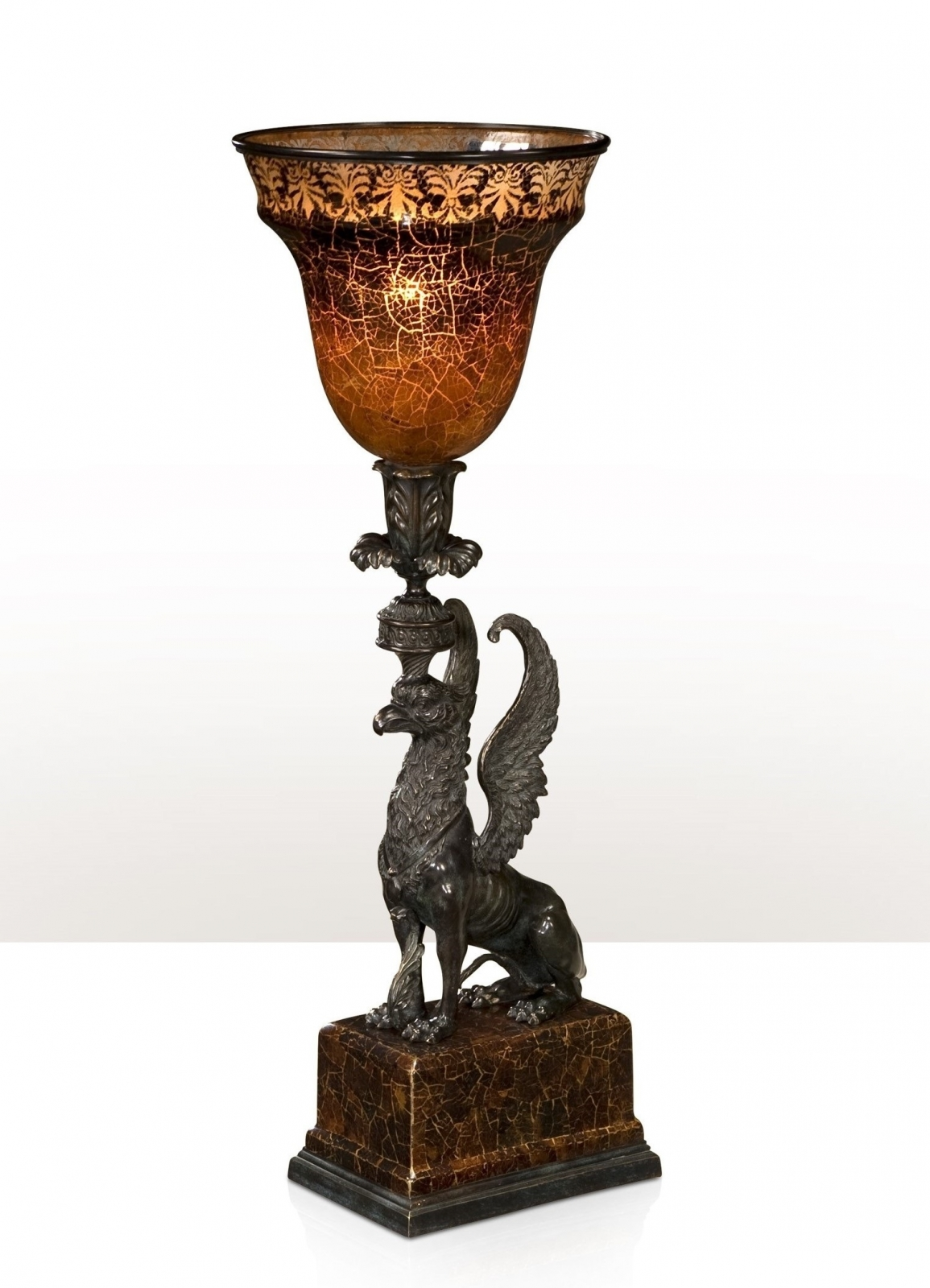 A verdigris brass table lamp with winged sphinx