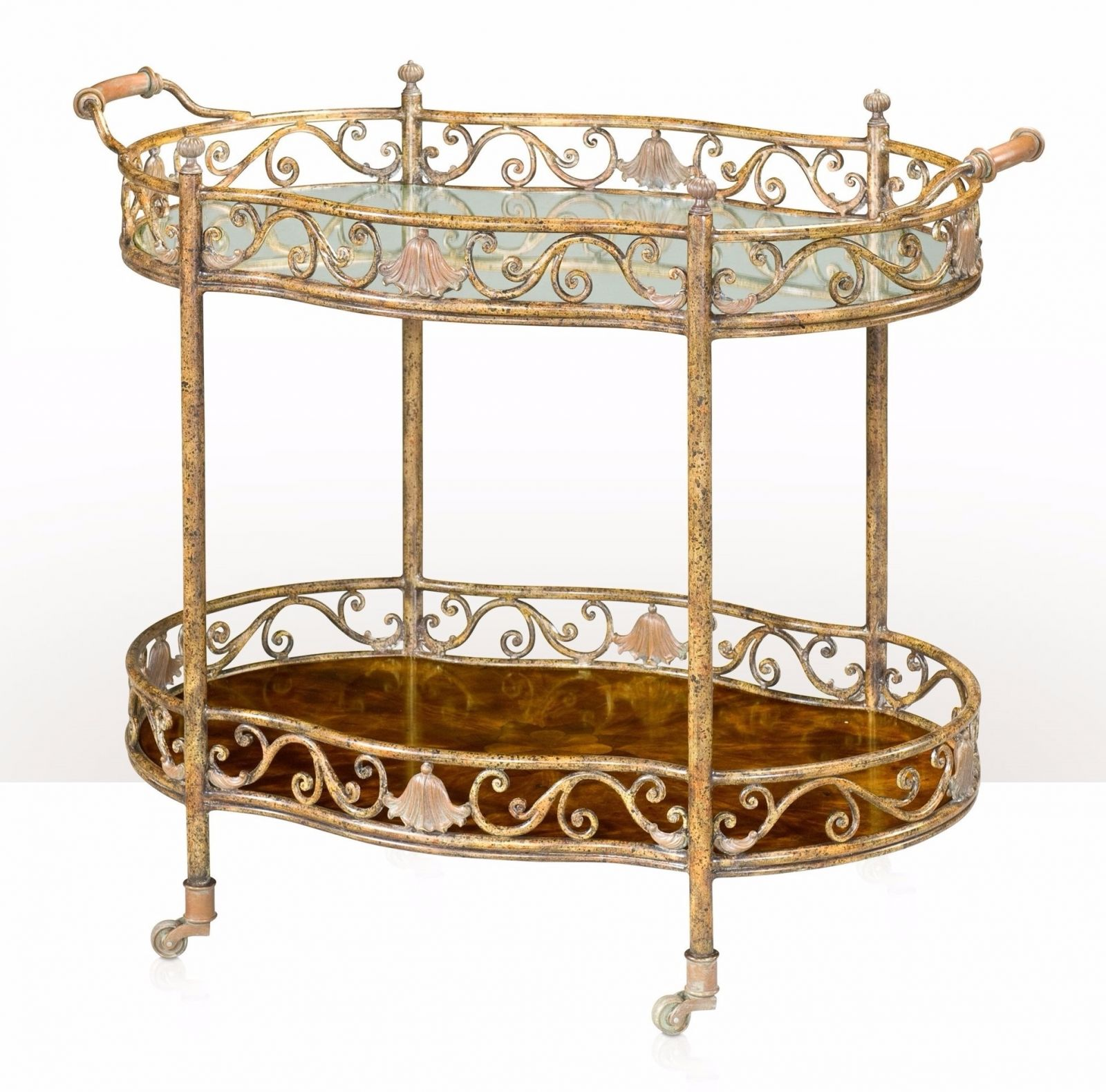 A rustic gilt iron and antiqued brass mounted tray table