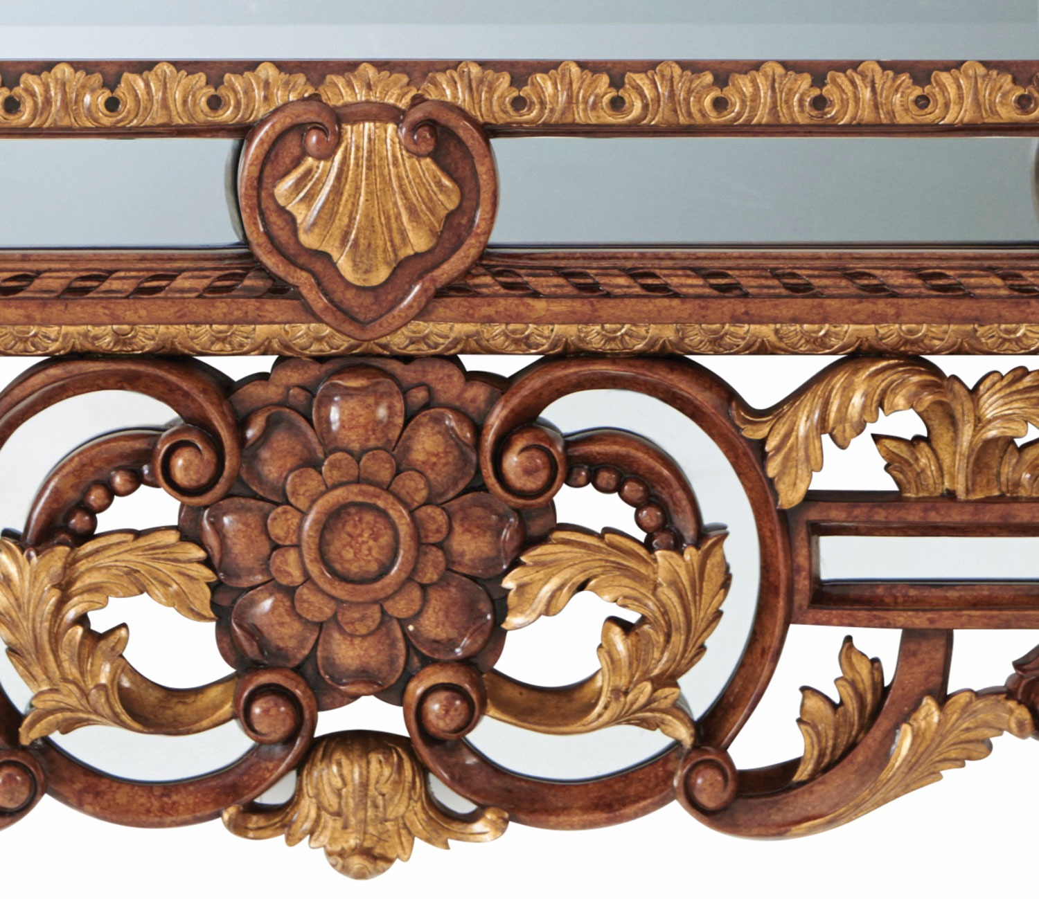 A carved wood and parcel gilt mirror