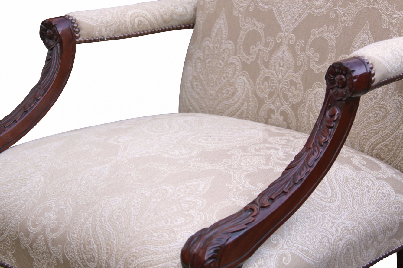 Hand carved mahogany chair in Linwood fabric