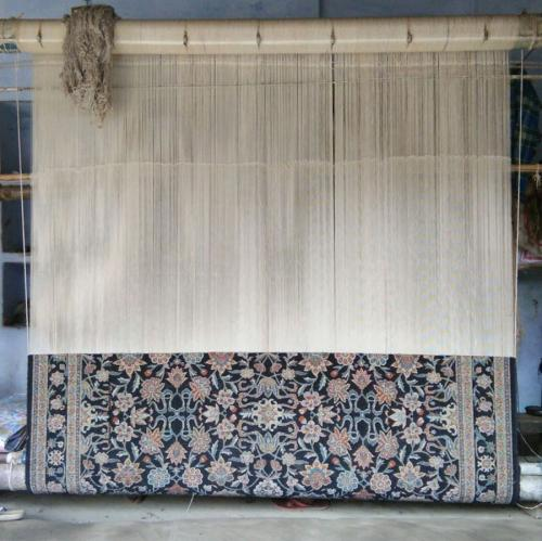 One of the rugs on the loom