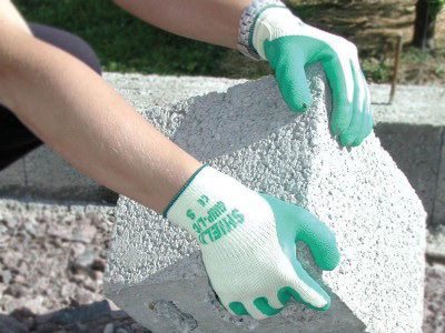 Green rubber coated knitted gloves