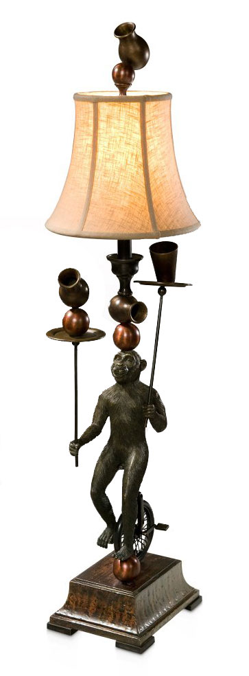 A finely cast brass monkey lamp