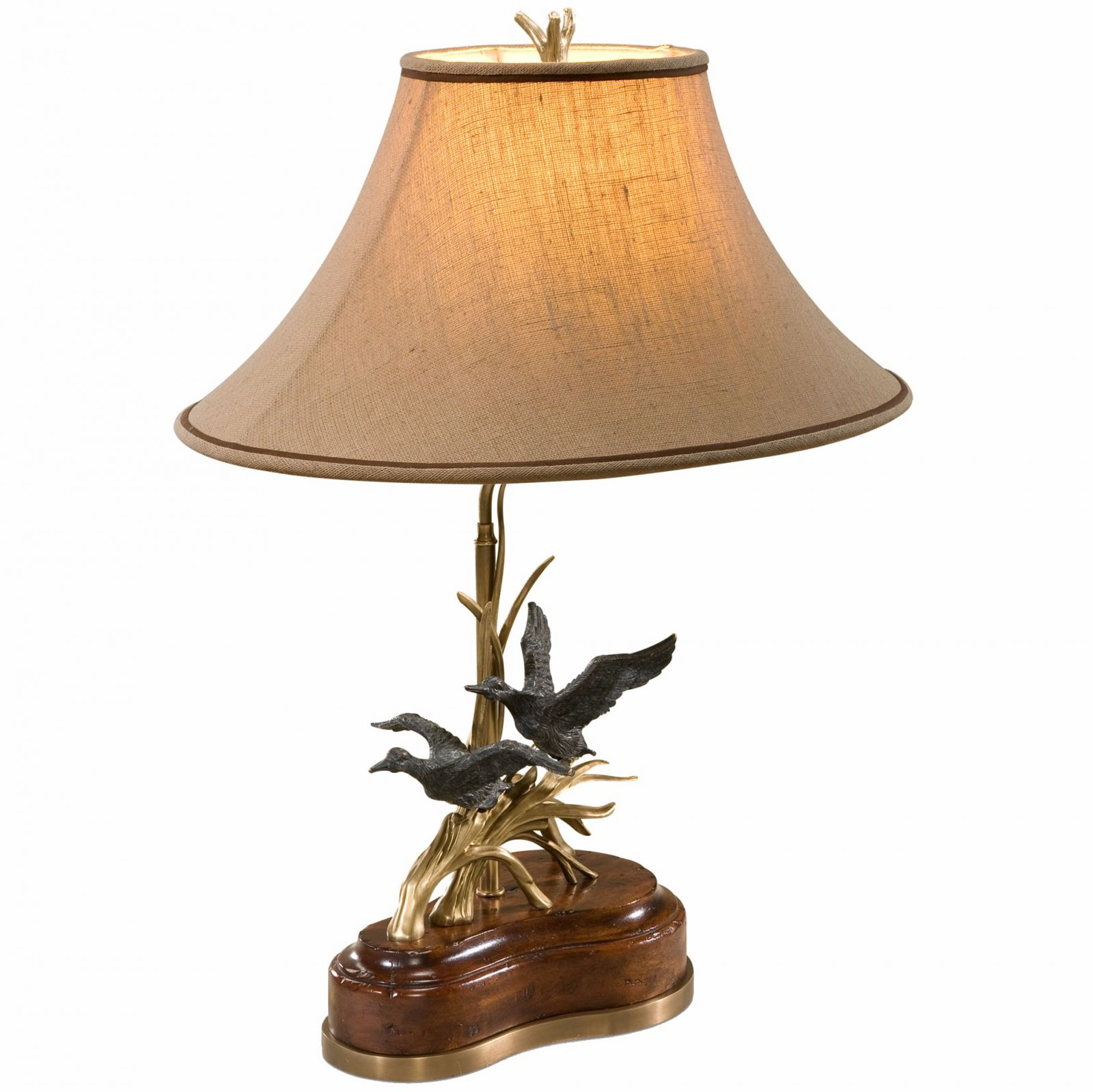 A finely cast brass and mahogany table lamp