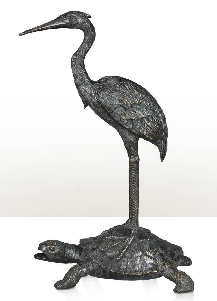 A Chinoiserie verdigris brass statue of a crane