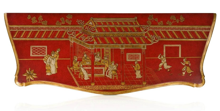 A Chinoiserie red lacquer serpentine bombe chest of drawers