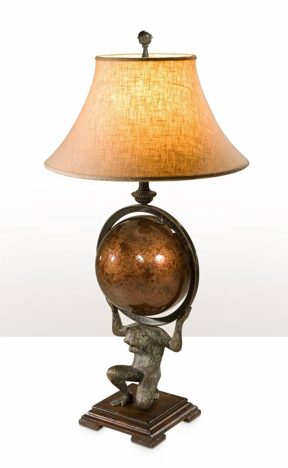 A table lamp of a monkey as Atlas