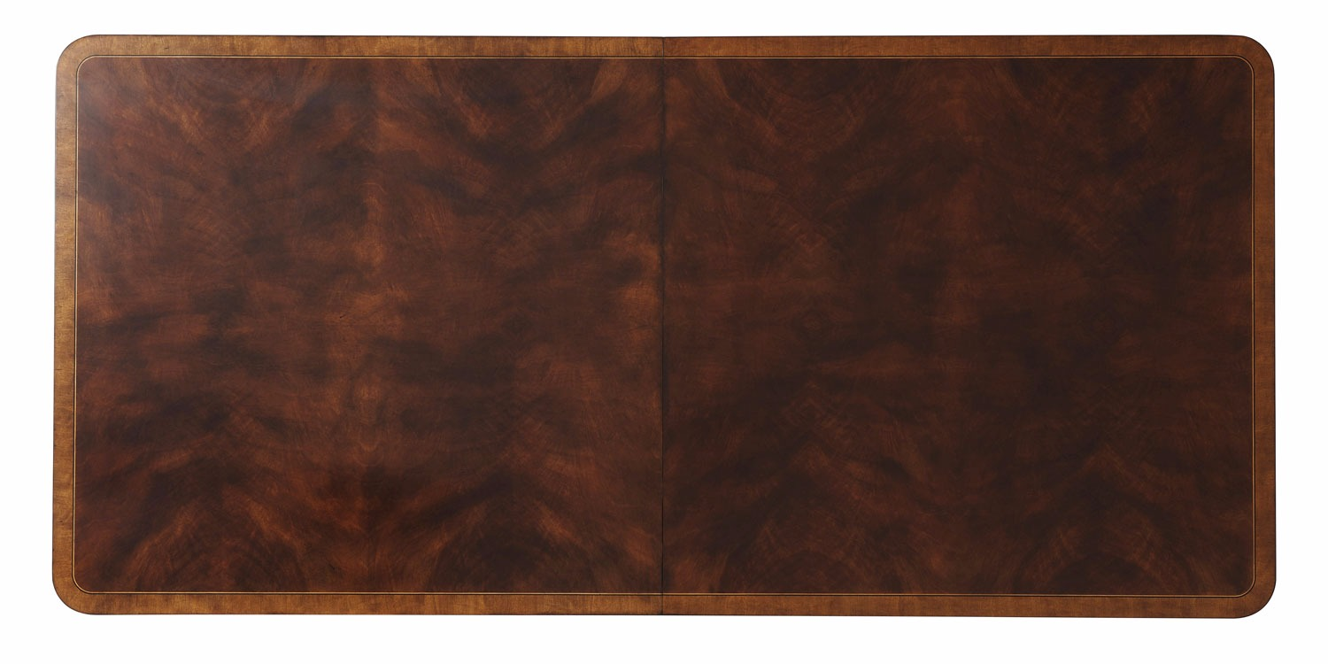 A swirl mahogany veneered dining table