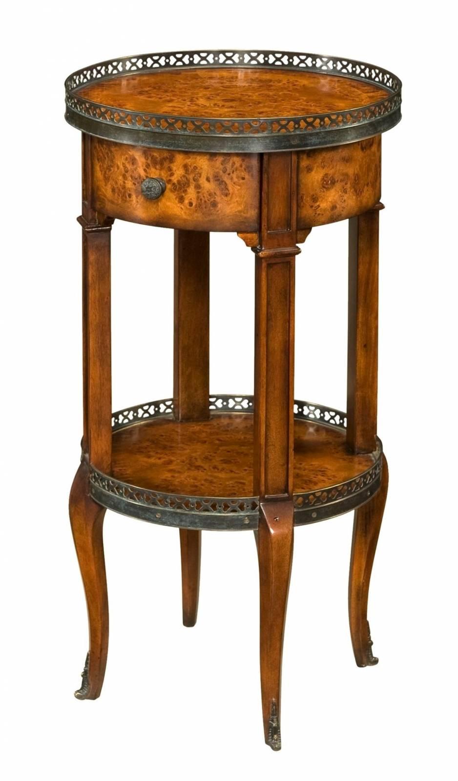 A circular poplar burl lamp table