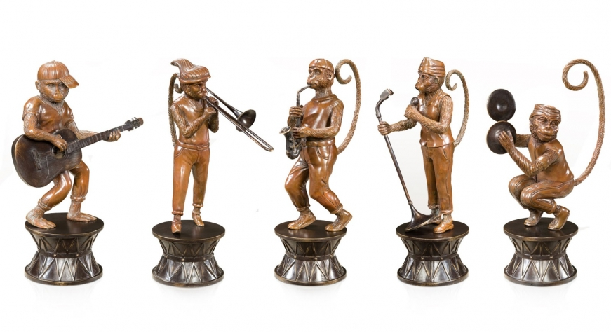 Antiqued brass figures of a band of monkeys