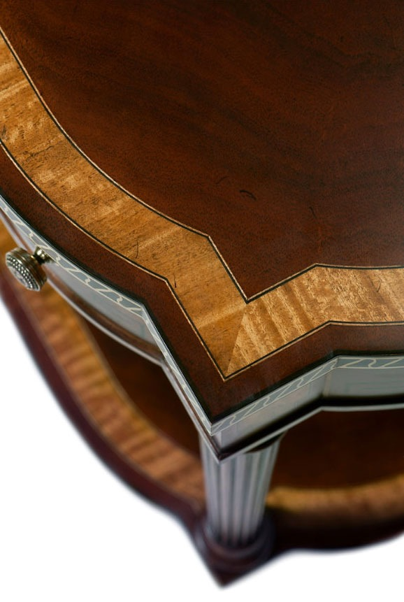A mahogany veneered and satinwood strung accent table