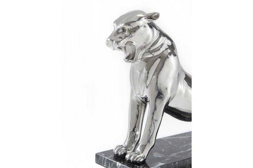 stainless steel sculpture of a roaring panther
