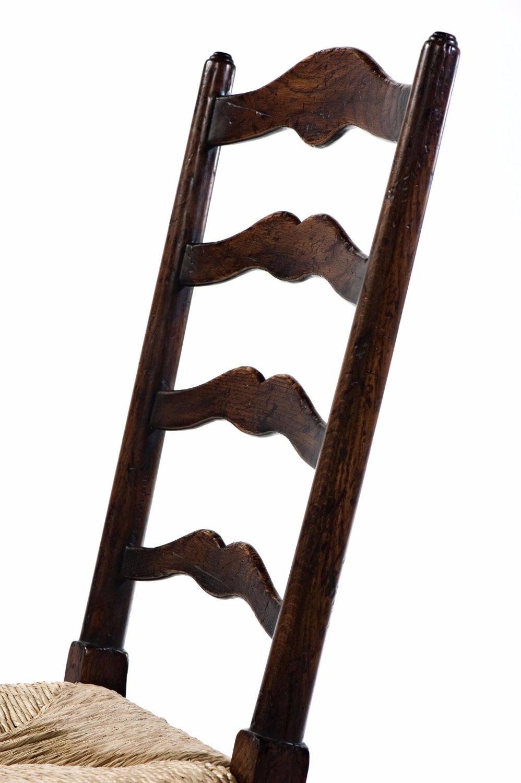 An oak ladder back side chair