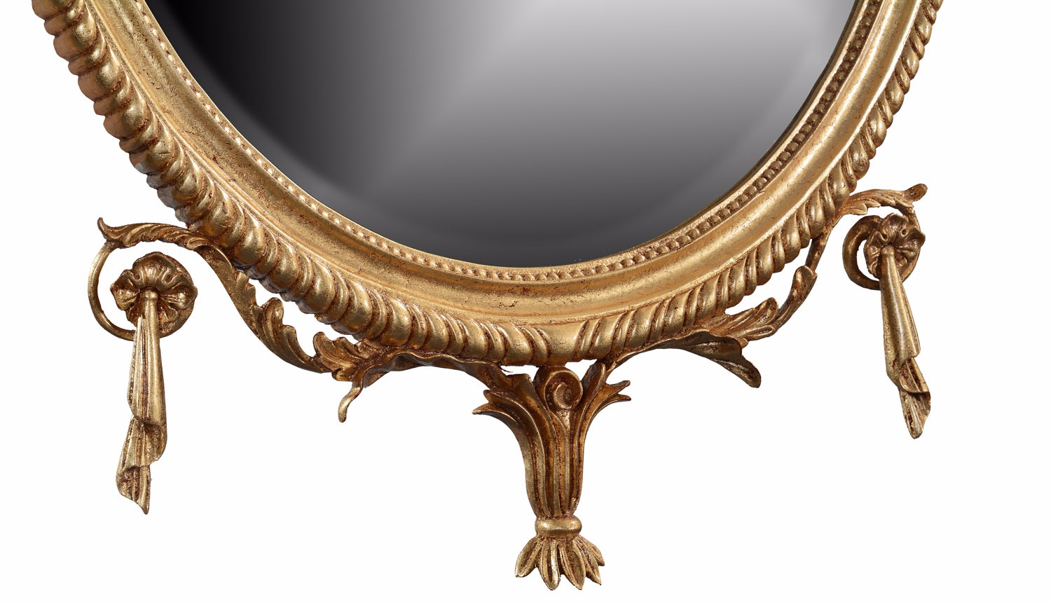 Hand carved oval giltwood mirror with bell flowers