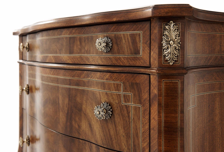 A Noix finish flame Etimoe veneered nightstand