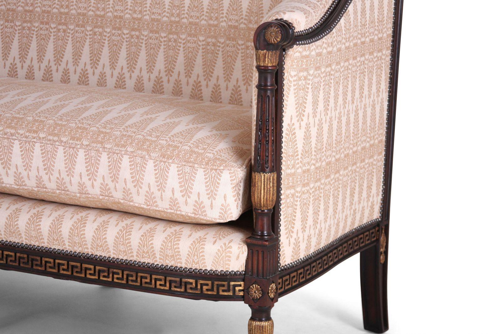 Mahogany and parcel gilt sofa