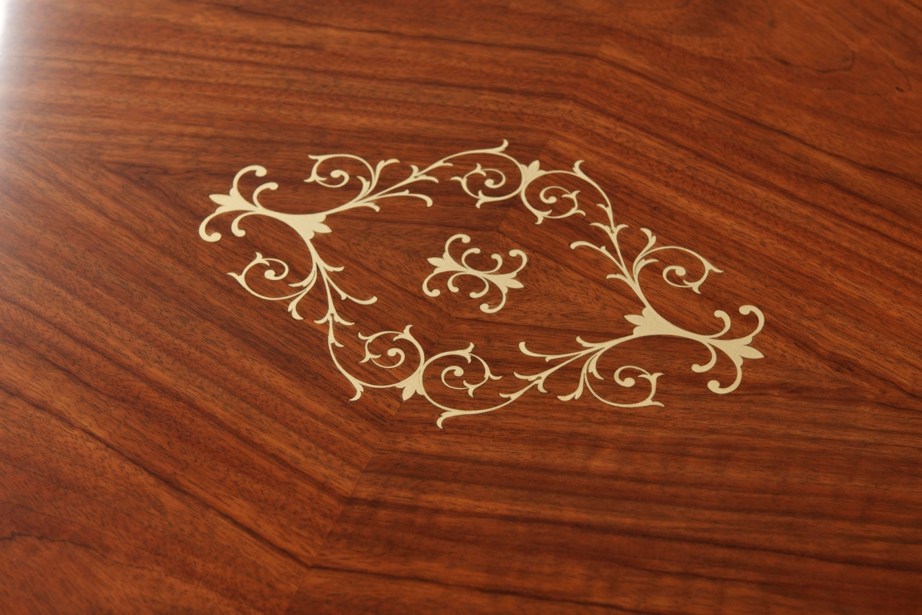 Highly figured coffee table with brass inlays