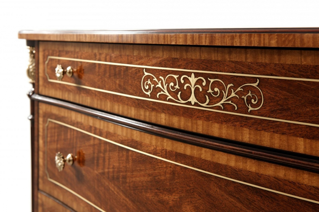 Brass inlaid serpentine chest of drawers