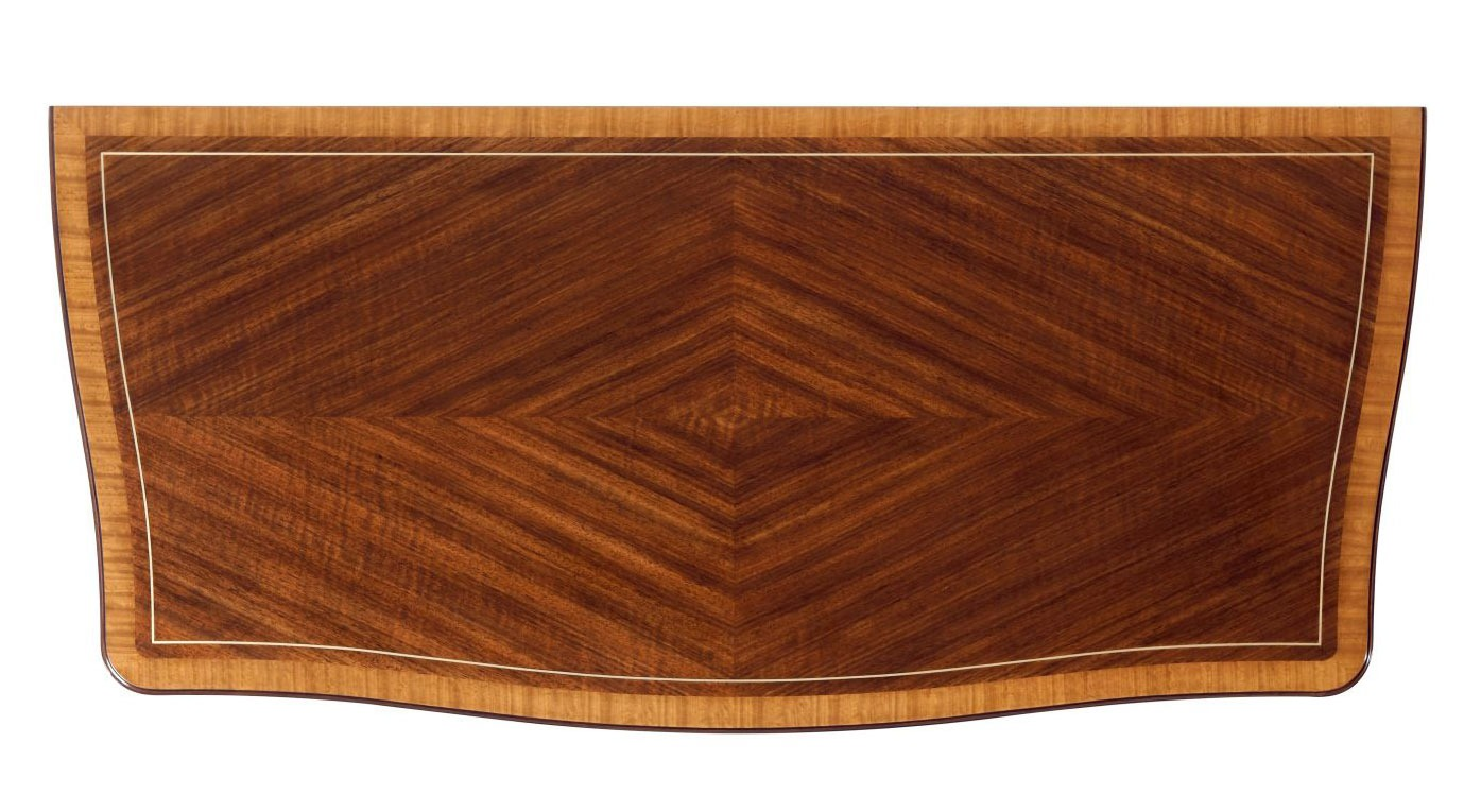 Brass inlaid serpentine chest of drawers