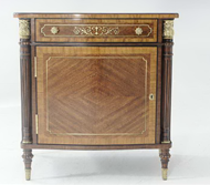 Brass inlaid serpentine nightstand