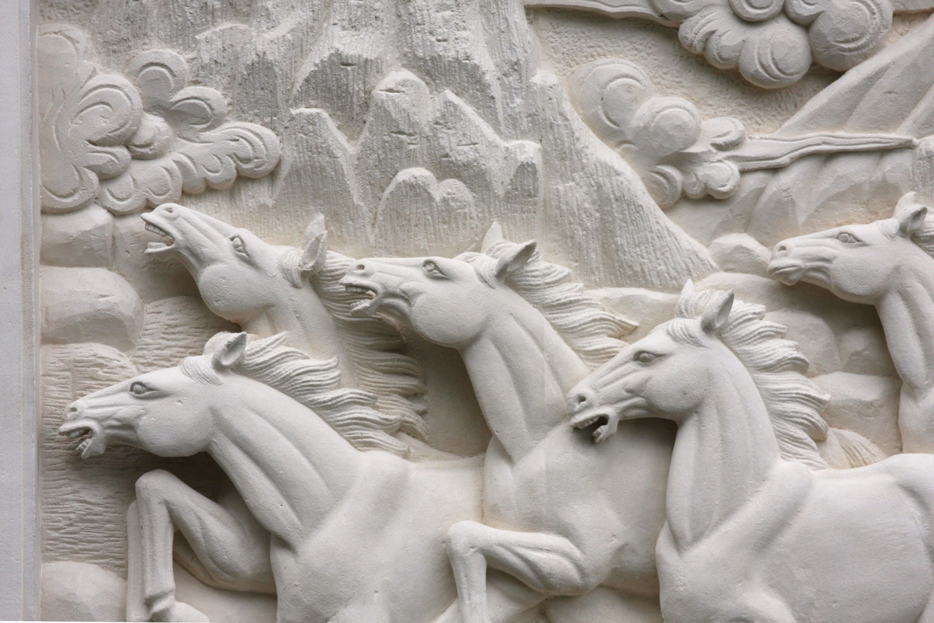 Hand carved stone wall plaque - Horses