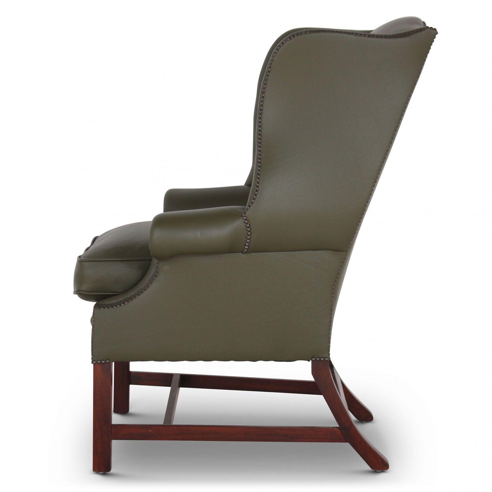 Georgian wing chair in green leather