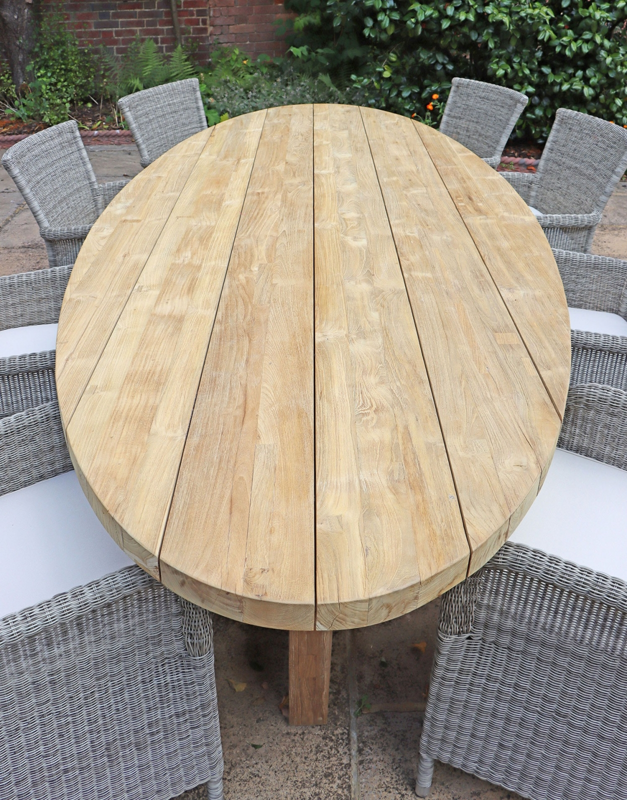 Flores solid teak oval dining set
