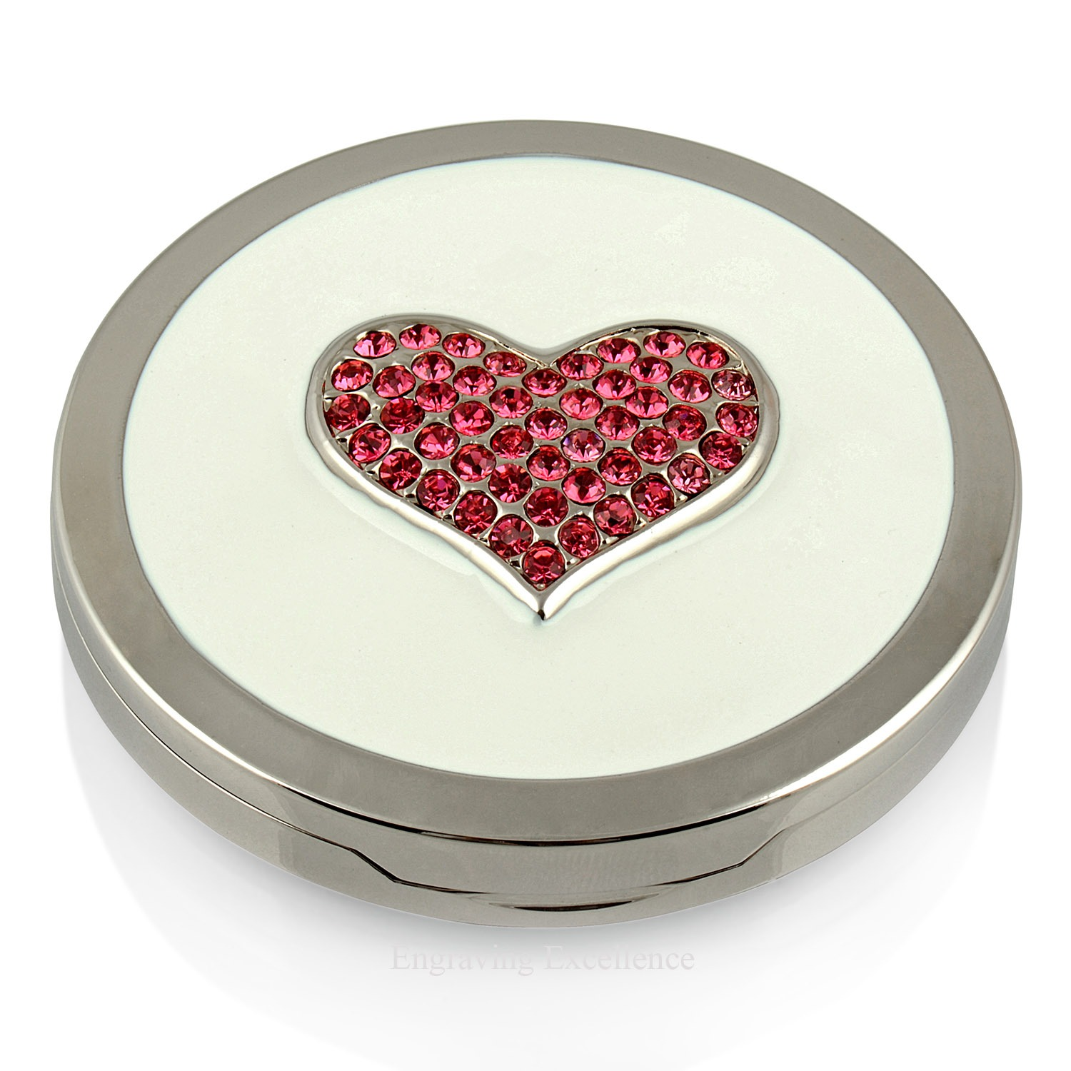 Round compact mirror with crystal heart